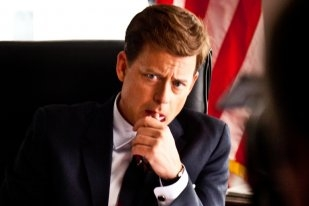 Greg Kinnear at his desk - The Kennedys