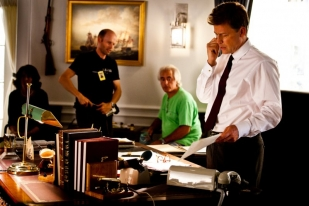 Greg Kinnear looking at desk - The Kennedys