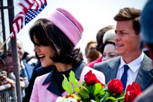 Greg Kinnear and Katie Holmes holding flowers - The Kennedys